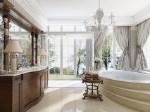 Badrummet i lyxig neo-klassisk stil med vaskar badar och en lar Arkivfoton