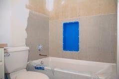 Badrummet omdanar klart för tegelplatta royaltyfria bilder