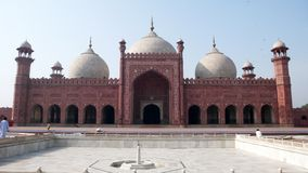 Badshahi Mosque. The Badshahi Mosque (Urdu: بادشاھی مسجد), or the 'Emperor's Mosque', was built in 1673 by the Mughal Emperor Aurangzeb in Lahore Stock Photos