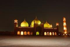 Badshahi Mosque. One of the biggest mosques of the world Badshahi Masjid illuminated at night Stock Images