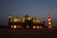 Badshahi Mosque. One of the biggest mosques of the world Badshahi Masjid illuminated at night Stock Photo