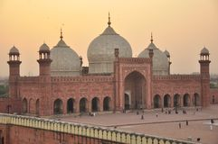 Badshahi Mosque at dawn, Lahore, Pakistan. Badshahi Mosque at sunset, Lahore, Pakistan.The Badshahi Mosque or the Royal Mosque in Lahore. Commissioned by the Stock Image