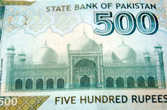 Badshahi Mosque, Lahore on banknote. Used Pakistan banknote for five hundred rupees showing the  Badshahi Mosque in Lahore.  Used banknote, photographed at an Stock Image