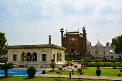 Badshahi Mosque Lahore & Tomb of Allama Iqbal. The Badshahi Mosque or the `Royal Mosque` in Lahore, commissioned by the sixth Mughal Emperor Aurangzeb in 1671 Royalty Free Stock Images