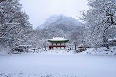 Baekyangsa Temple and falling snow, Naejangsan Mountain in winter with snow. Stock Photo