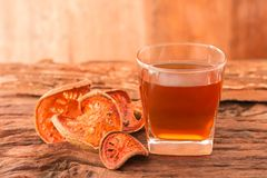 Bael fruit tea. A glass of  and dried fruit on a rustic wooden background, Bale beverage, Close up, Selective Focus Stock Photos