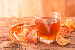 Bael fruit tea. A glass of  and dried fruit on a rustic wooden background, Bale beverage, Close up, Selective Focus Stock Photography