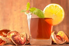 Bael fruit tea. A glass of  with lemon slices and mint leaf on a rustic wooden background. Beal beverage, Close up, Selective Focus Royalty Free Stock Photo
