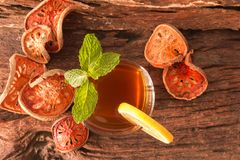 Bael fruit tea. A glass of  with lemon slices and mint leaf on a rustic wooden background. Beal beverage, Top view, Selective Focus Royalty Free Stock Photography