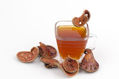 Bael water and Slices of dried bael fruit. (Aegle marmelos) Royalty Free Stock Photo