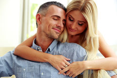 Baeutiful couple hugging with eyes closed Royalty Free Stock Images