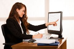 Baeutiful young business woman working at her desk in the office Royalty Free Stock Image