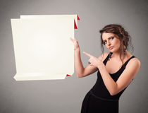 Young woman holding white origami paper copy space Stock Images