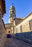 Alley of historical nucleus of Baeza, Andalusia. Baeza, Andalusia, Spain: Alley view of the medieval core with the bell tower of the Cathedral of Santa Maria stock photos