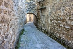 Medieval nucleus of Baeza, Andalusia. Baeza, Andalusia, Spain: Latticework of narrow streets that surround the cathedral, which present / display several arcs royalty free stock image