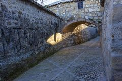 Historical nucleus of Baeza, Andalusia. Baeza, Andalusia, Spain: View of an arch of one of the arches that intersect in the alleyways of the historic core royalty free stock photo