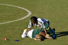 Bafana Bafana Soccer Team Physiotherapist. Attends to a player down with cramp Stock Photography