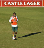 Bafana Bafana Soccer Team Practice. Bafana Bafana (South African National Soccer Team) - dribbling balls across the filed, flanked by the Castle Lager branded Stock Photography