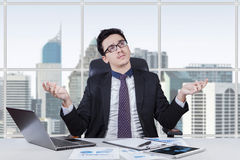 Baffled businessman finding an idea Stock Photos