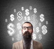Baffled man and dollar signs on blackboard Stock Image
