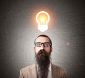Baffled man with glowing light bulb Royalty Free Stock Photos