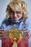 In bag. Blond lady with shopping christmas bag Royalty Free Stock Photo