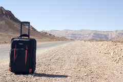 Bag. Travel bag on the side of the road in the middle of the nowere Royalty Free Stock Photos