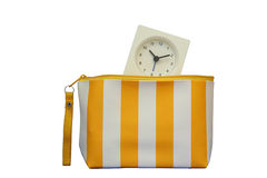 Bag and alarm clock. Time in the bag,isolated on white background Royalty Free Stock Images
