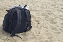 Bag on the beach. Bag with contents on the beach close up Royalty Free Stock Photography