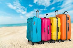 Bag on beach. Polycarbonate pocket rolls booking white travel stock photo