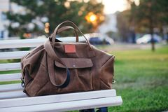 Bag on the bench in autumn park Royalty Free Stock Photography