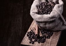 Bag of black coffee beans stock image