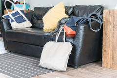 bag on black leather sofa Royalty Free Stock Photo