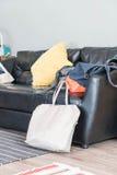 bag on black leather sofa Royalty Free Stock Photography