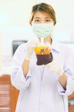Bag of Blood in hand asian Doctor Royalty Free Stock Photography