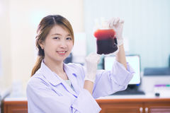 Bag of Blood in hand asian Doctor Stock Photography