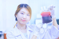 Bag of Blood in hand asian Doctor Stock Image