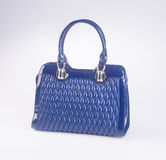 bag. blue colour fashion woman bag on a background. Royalty Free Stock Photo