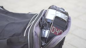 Bag with a bomb on the street, a ticking timer. Close up stock video footage