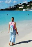 The Bag Of Books. The girl walking along Philipsburg town beach with a bag of books (St.Maarten, Netherlands Antilles Royalty Free Stock Photography
