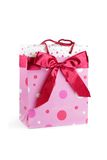 Bag with a bow. Pink bag with dots and satin bow. Isolated on white Stock Images