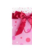 Bag with a bow. Pink bag with dots and satin bow. Isolated on white Royalty Free Stock Image