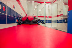 Bag with boxing gloves in locker room Royalty Free Stock Image