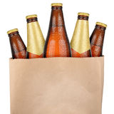 Bag with brown beer. Bottles isolated on white background Royalty Free Stock Photo