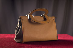 Bag brown color on red velvet background Stock Photo
