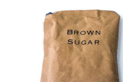 A bag of brown sugar - isolated over white background Royalty Free Stock Image