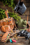 Bag, bullets and hat in a hunting lodge Royalty Free Stock Photo