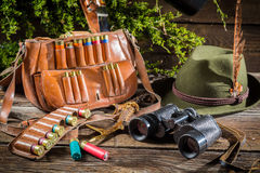Bag, bullets and hat in a hunting lodge Royalty Free Stock Photography