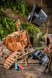 Bag, bullets and hat in a hunting lodge Royalty Free Stock Images