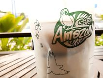 Cafe Amazon logo on coffee container for holding outside, famous brand in Thailand royalty free stock images